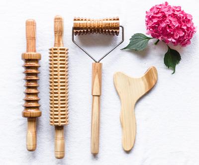 Sprostilni kotiček: masaža z lesenimi valjcki